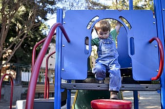 Toddler standing on playhouse