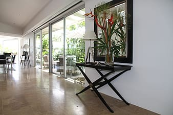Black wooden table and mirror beside clear glass sliding door