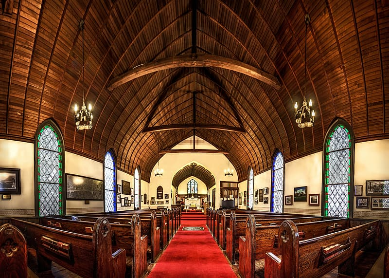 Brown wooden pews in church