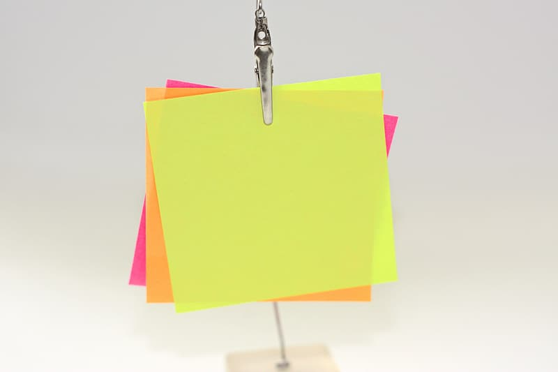 Three assorted-color papers on metal clip