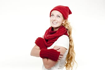Woman wearing scarf, beanie, and thermal gloves