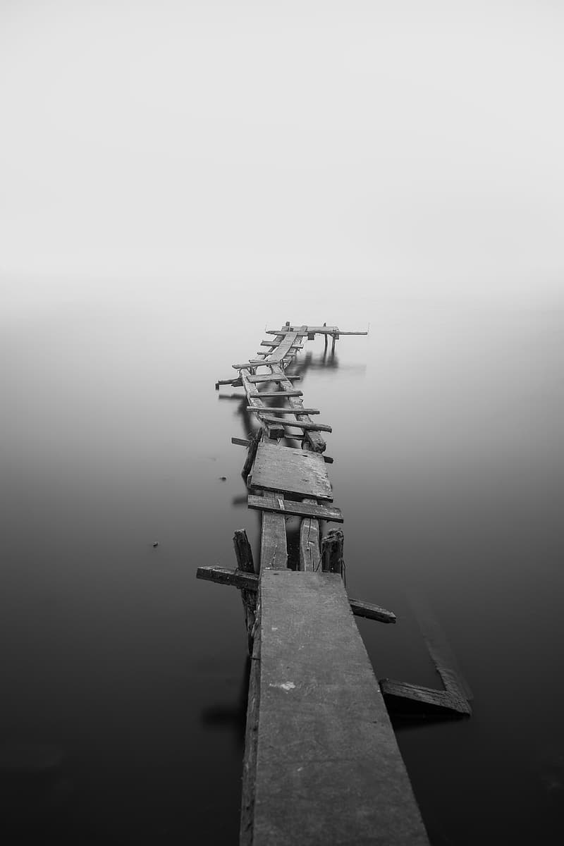 Gray river dock with fog