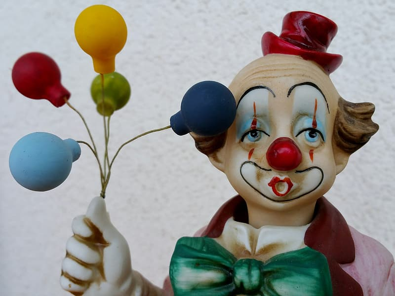 Clown holding balloons figurine