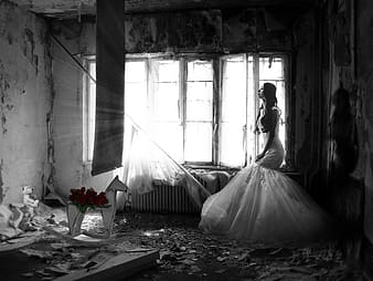 Woman in white dress inside dark messy room