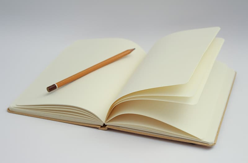 White open notebook and pencil photo