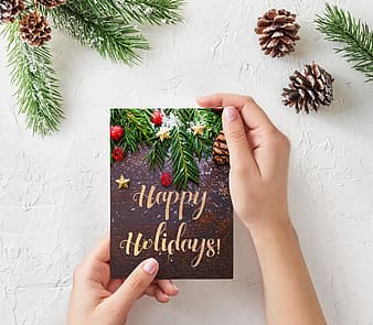 Person holding Happy Holidays greetings card