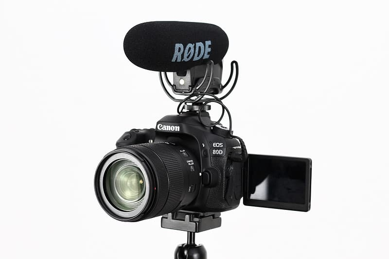 Turned-off black Canon EOS DSLR camera with microphone