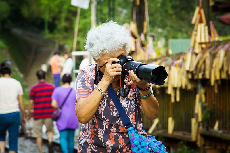 Woman taking picture using DSLR camera
