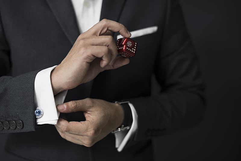 Person holding dice and dress shirt