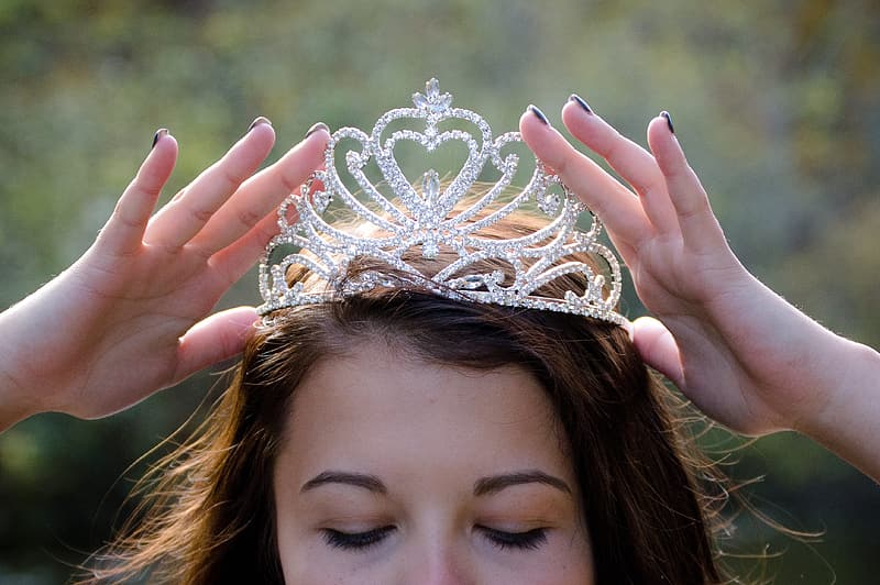 Woman holding crown on head