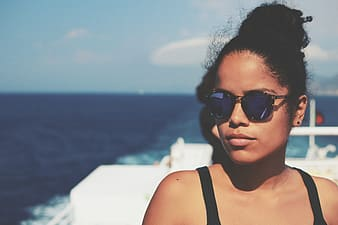 Woman in blue lens sunglasses