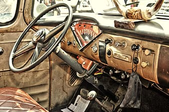 Close up photography of brown and black vehicle steering wheel