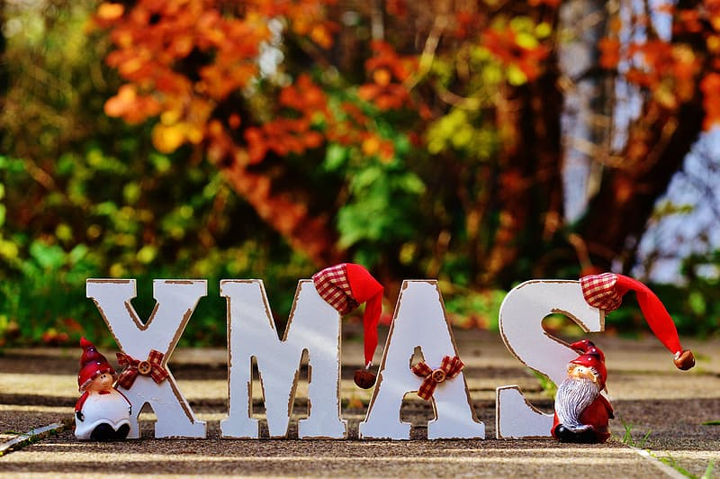 White wooden Xmas-themed text table decor on floor