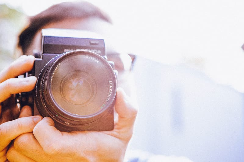 Photography of a person holding a camera