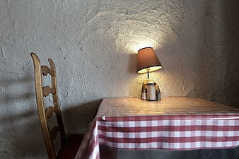 Brown table lamp on table with gingham tablecloth