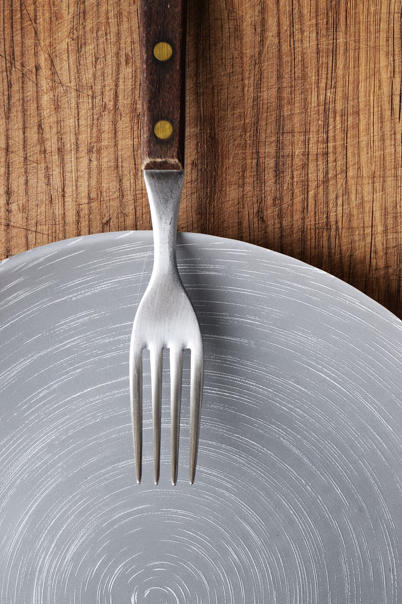 Stainless steel fork with brown handle