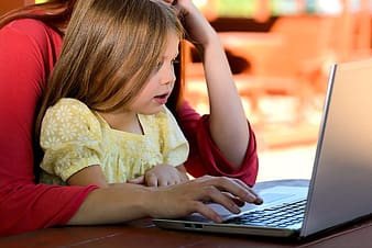 Woman and child watching on laptop
