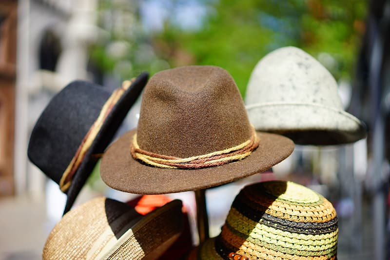 Assorted-color hats on hat stand