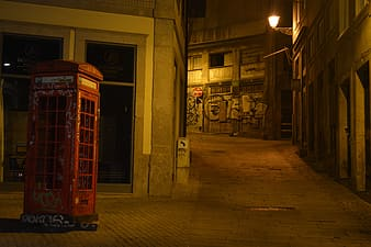 Telephone booth beside pathway