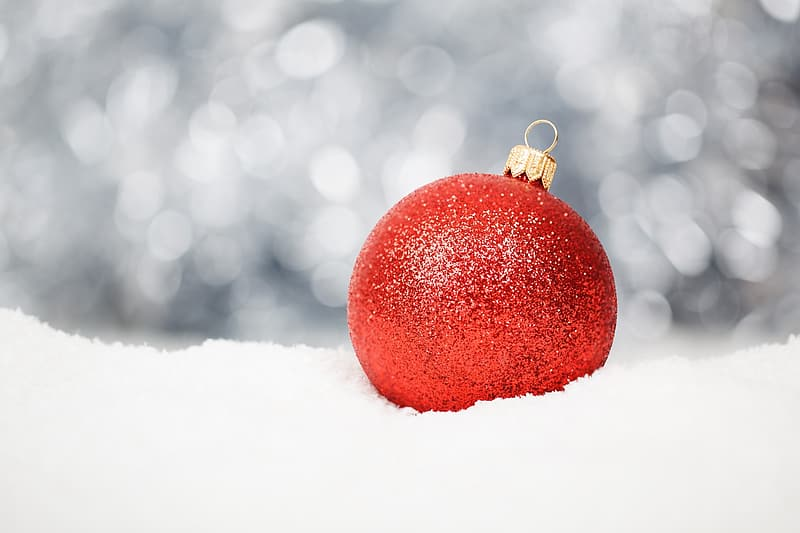Red baubles on white surface