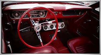 Red and grey car steering wheel