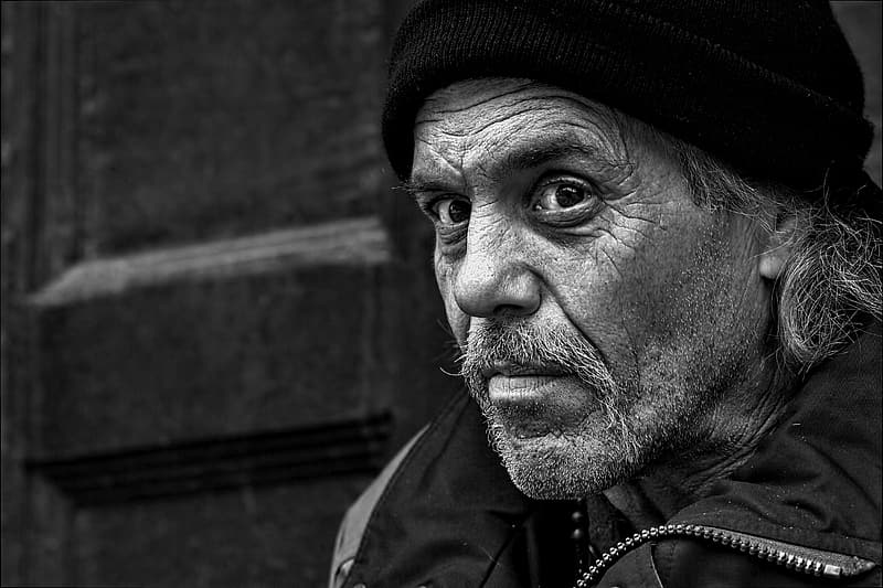 Grayscale photo of man in jacket and beanie hatt