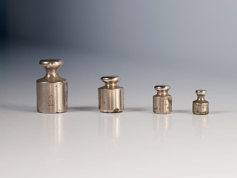Four gray metal tools on white surface
