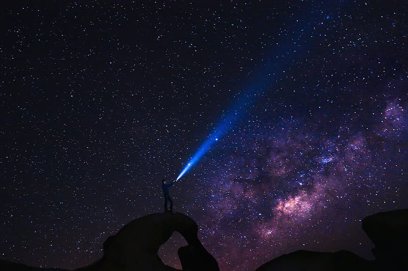 Silhouette of man under starry night