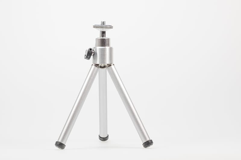 Silver and black telescope with white background