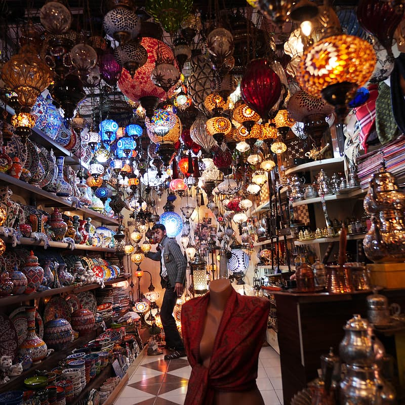 Man standing inside store full of lanterns