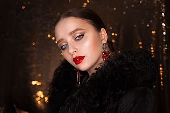 Woman wearing black fur coat