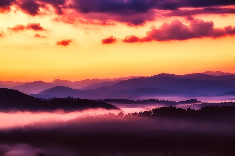 Silhouette of mountain range with fog