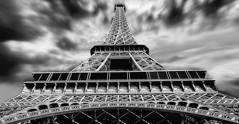 Low-angle grayscale photo of Eiffel tower