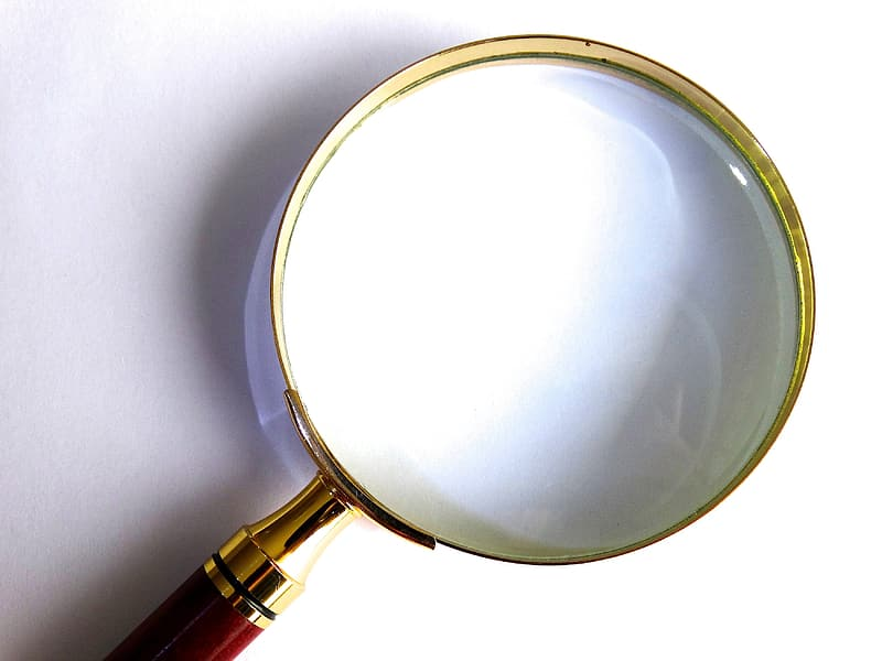 Red handle magnifying glass on white surface