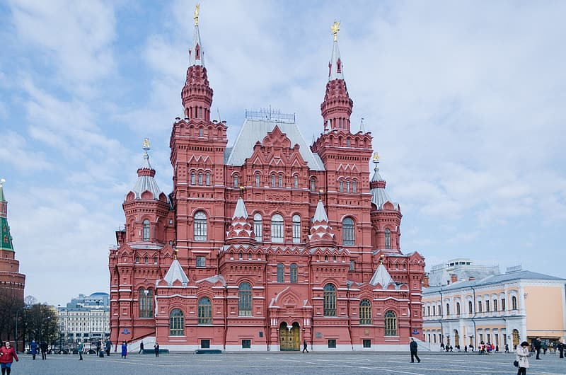 Red castle surrounded by buildings
