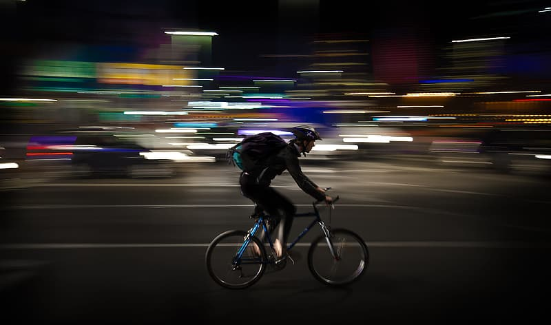 Timelapse photography of man rigid bicycle