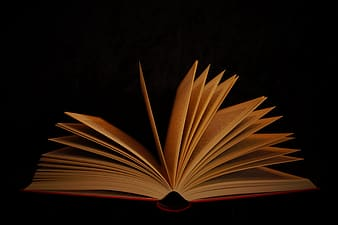 Book opened with black background
