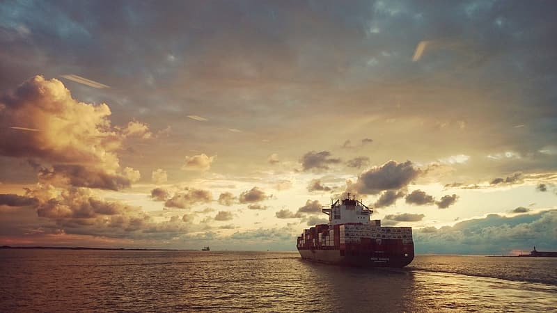 Red and white cargo ship
