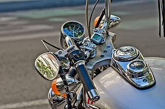Selective-focus photography of white motorcycle