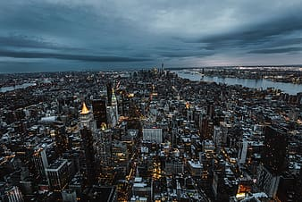Aerial photography of city under white sky during night time