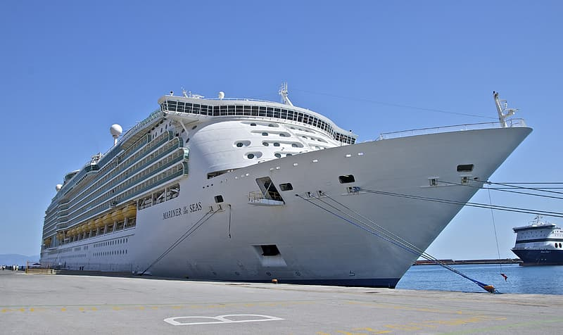White cruise ship docked on pier