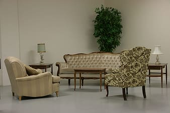 Brown-and-gray couch set beside two white table lamps