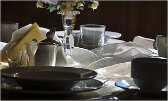 Assorted glass dinnerware set on table