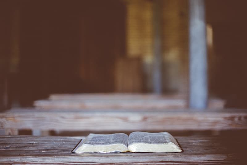 Open book and wooden beam