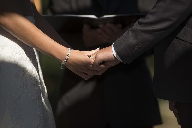 Man and woman holding hands together