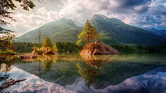 Body of water with mountain in the background