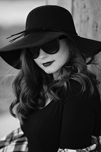 Grayscale photo of woman wearing black sunhat