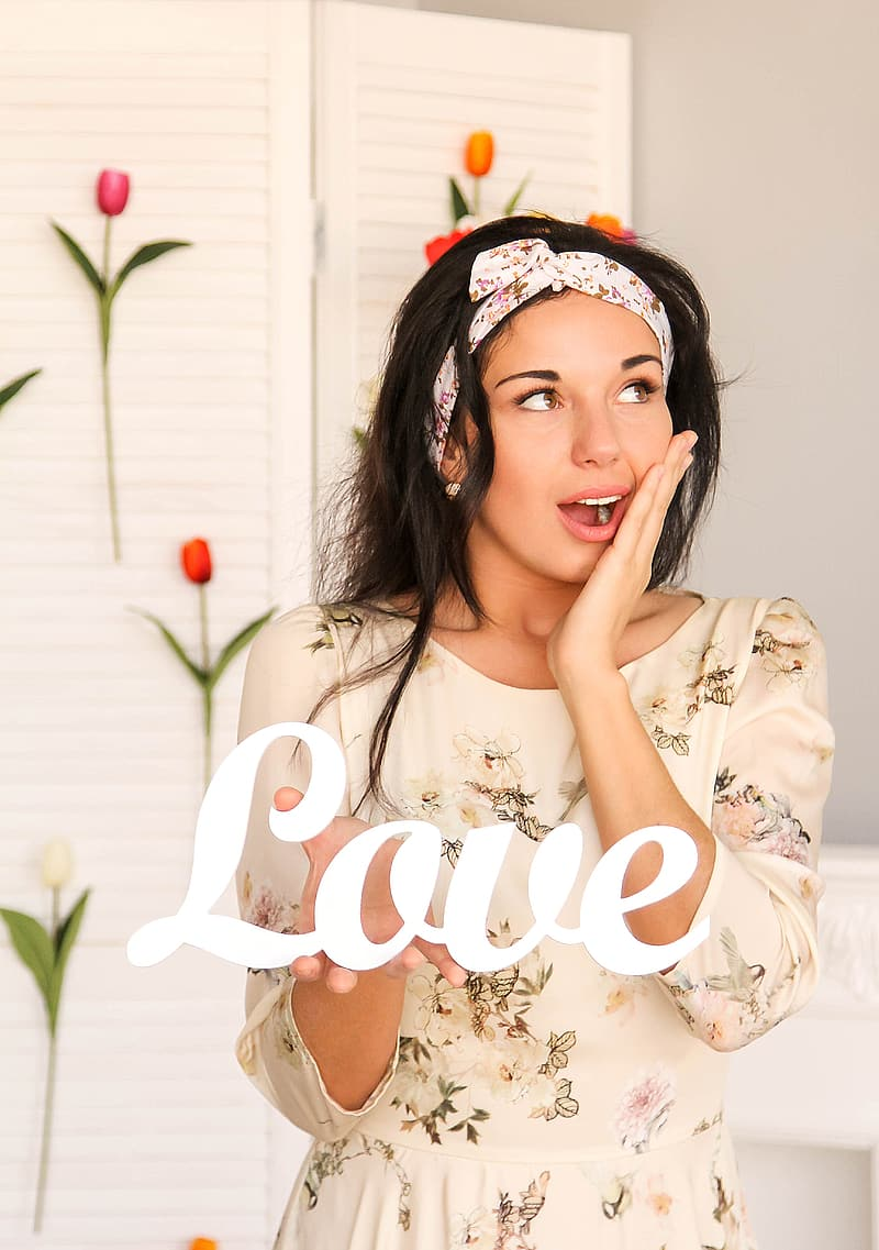 Woman wearing white floral dress with Love text overlay