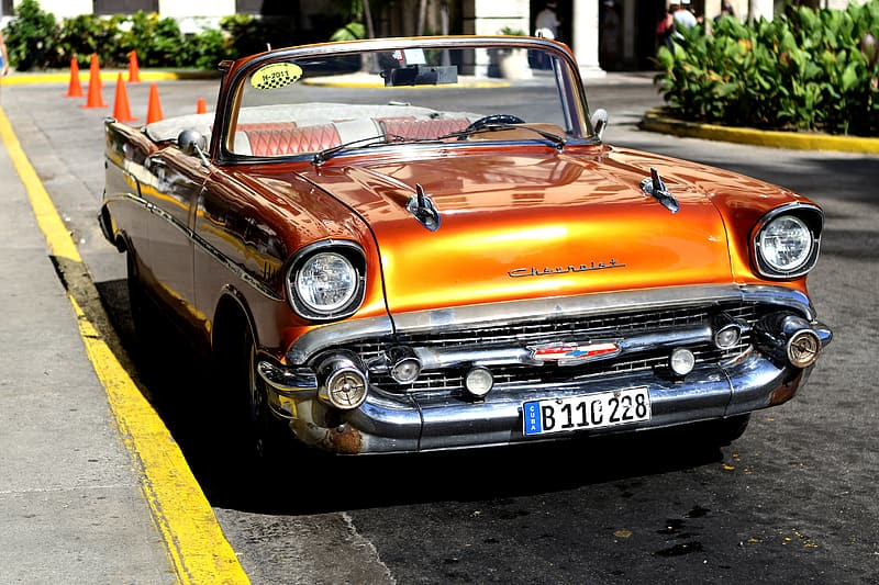 Orange convertible coupe on road