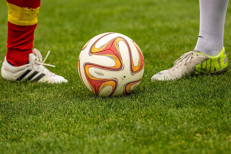 White and red soccer ball in field